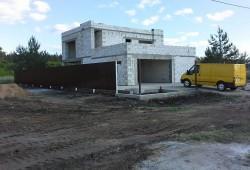 Дом из бетонных блоков с гаражом