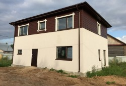 Стильный двухэтажный дом с отделкой